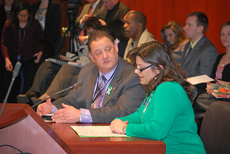 Rep. Bolinsky supports Newtown Town Clerk Debbie Aurelia as she delivers emotional testimony at a public hearing.